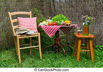 Seats and table in a quiet corner of the garden
