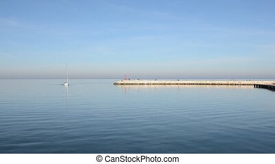 Quiet return of sailboat to the port