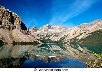 Quiet scenery of Bow Lake with the Rocky Mountains reflecting