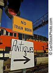 Quiet train sign and antiques - Sign indicates the passing...