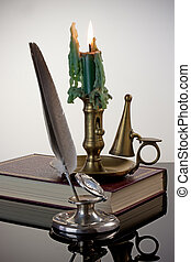 Quill Pen and Candlestick - Antique inkwell and quill pen...