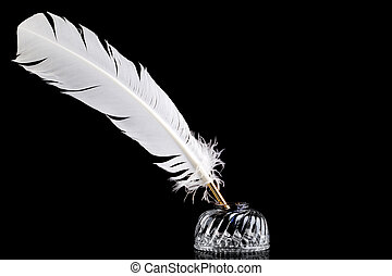 Quill pen and inkwell on black background - A white feather...