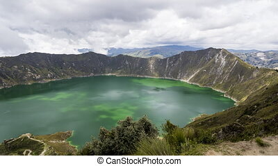 Quilotoa is a water filled crater lake and the most western volcano in the Ecuadorian Andes. Caldera with turquoise body of water and a popular hiking trail called quilotoa loop.