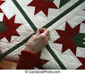 Quilter 01 - Woman hand quilting red and green tone quilt