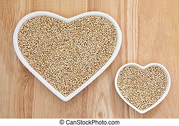 Quinoa grain super food in heart shaped porcelain dishes ...