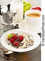 Quinoa porridge with raspberry and coconut flakes for...