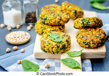 quinoa spinach chickpeas pumpkin fritters on grey wood...