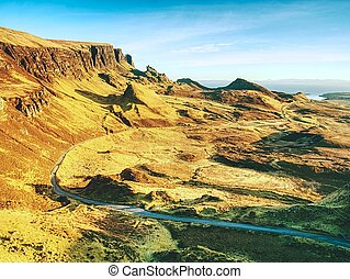 Quiraing mountains sunset with dramatic sky in Scottish highlands Isle of Skye