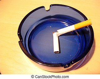 Quit smoking - A broken cigarette in an ashtray