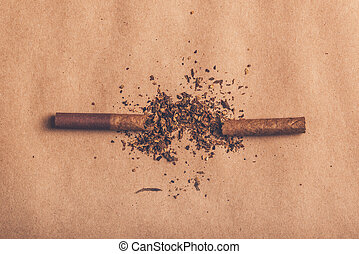 Quit smoking concept, broken cigarette top view