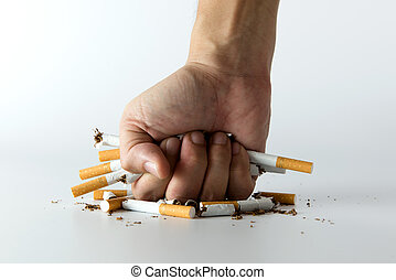 Quit smoking concept - Fist crashing cigarettes for quit...