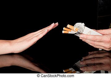 Quit smoking - Hand refusing the cigarettes offered to her
