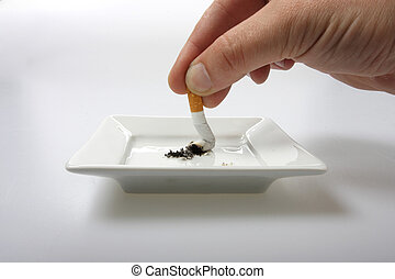 quit smoking - Hand stubbing out a cigarette on white...