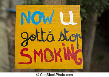 Quit Smoking placard with bokeh background, Cambodia - Quit...