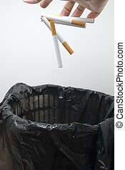 Quit smoking - Photo of cigarettes being dropped in a...