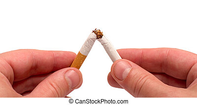 Quit smoking - Close up mans hands breaking a cigarette it...