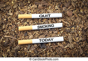 Quit Smoking Today - Three cigarettes with text quit smoking...