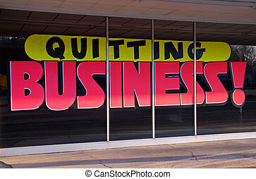 Quitting Business - A window sign advertising that business ...