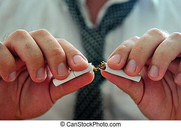 Quitting smoking - Concept photo of a man quitting smoking...