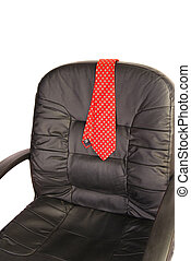 Quitting Time - Red mens neck tie draped over the back of a...