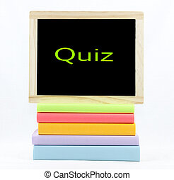 Quiz Chalkboard On Colored Books - Quiz text on a chalkboard...