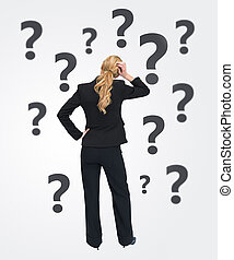 Quizzical businesswoman - Quizzical businesswoman with back...