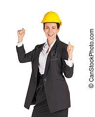 quoique, casque, jaune, elle, sourire, poing, porter, haut., femme affaires, construction, élévation