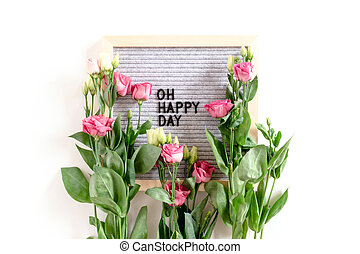 Quote Oh happy day. Flatlay with letter .board and eustoma flowers on white background
