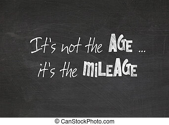 Quote about aging on dusty black chalkboard.
