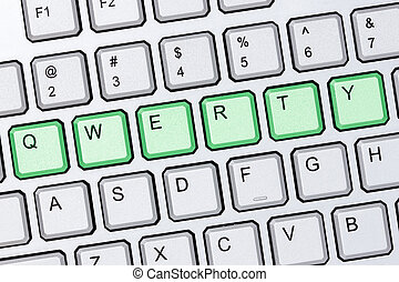 Green qwerty buttons on silver computer keyboard
