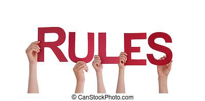 règles, tenant mains