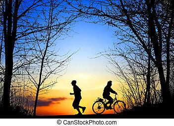 récréation, jogging, et, cyclisme, à, coucher soleil