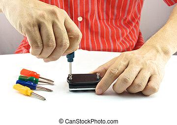 réparer homme, tournevis, coloré, utilisation