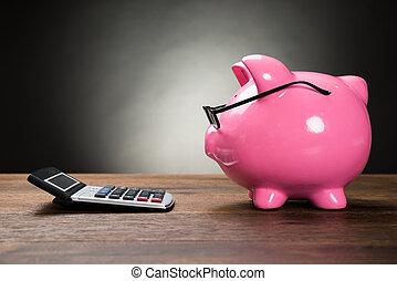 rózsaszín piggybank, és, számológép