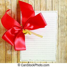 röd remsa, med, tom, anteckningsbok, över, trä, bakgrund