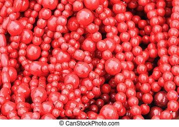röd, trä, pärlhalsband, som, stilig, röd fond, med, målad, ved struktur