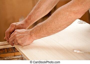ręka człowieka, pracujący dalejże, drewno