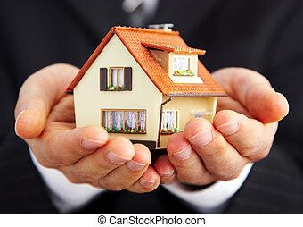 ręka, od, przedimek określony przed rzeczownikami, biznesmen, z, przedimek określony przed rzeczownikami, dom