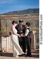Rabbi Marrying Gay Couple - Rabbi reading sacrament for...