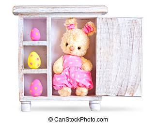 Rabbit bunny toy and easter eggs ona wood case isolated -...