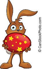 Rabbit holding A Large Easter Egg