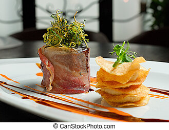 rabbit pate baked in bacon, with potato chips and sauce
