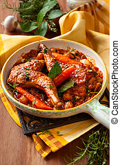 Rabbit stew with vegetables and herbs