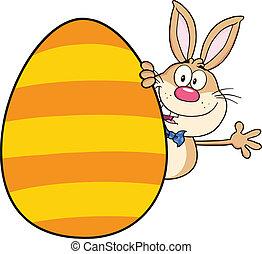 Rabbit Waving Behind Easter Egg