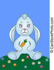 Rabbit with carrot on a meadow