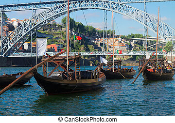 rabelo boats and bridge of Dom Luis , Portugal - traditional...