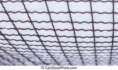 Rabitz under snow - Camera shows bottom mesh netting under...