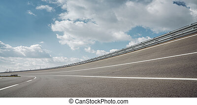 Race Car / motorcycle racetrack on a sunny day.