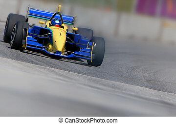 Race car - Open wheeled single-seater race car in a corner...