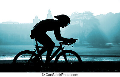 Race Day - Cyclist against rural backdrop